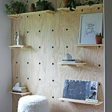 this giant pegboard accent wall is trendy and quite practical for of living to its an pegboard wall