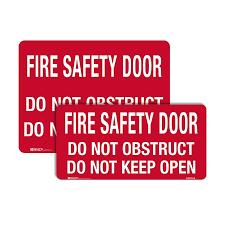 fire safety sign fire safety door do not obstruct do not keep open