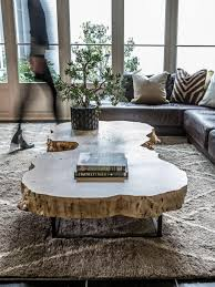 atlanta designer alice cramer says to clear the clutter off of your coffee table and use varying heights to make the surface a showpiece she