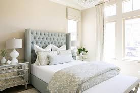 blue tufted wingback bed with mirrored
