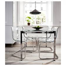 metal dining room chairs chrome:  cabinets with brown lapiz counters around the perimeter and stained espresso maple cabinets with white macaubas counters along the island the kitchen