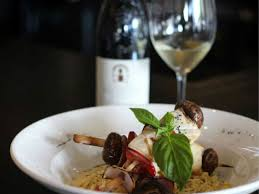 kebabs and glass of wine at sallio bistro in dallas