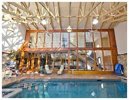 wood patio with pool. Large Outdoor Pool With Two Story Covering Built In Wood. Pool Is Directly  Accessed From Wood Patio P