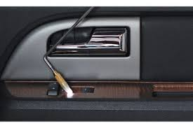 after gaining access to the car s interior the locksmith inserts a long tool to manually pull open lock tabs or press ons to unlock the door