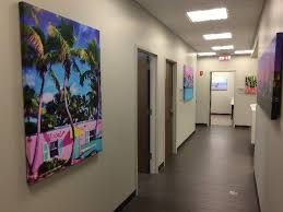 art for commercial spaces on display in a hallway on wall art for office building with art for commercial spaces buildings and offices corporate artwork