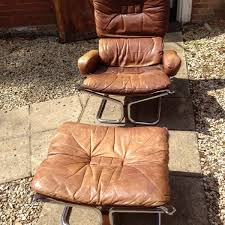 mid century leather and chrome chair