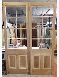 1 pair poplar 8 glazed panes over 2 panel victorian doors