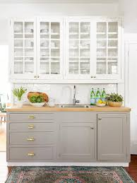 glass front upper cabinets with dove gray lower cabinets