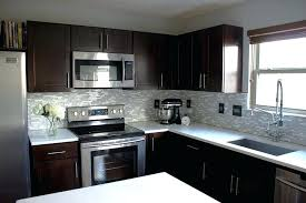 dark cabinets light countertops contemporary kitchen chocolate
