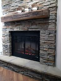 rustic look stacked stone fireplace ideas with wood mantel