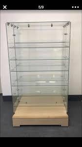 frameless glass rolling display cases gondolas maple wood bottom adjule glass shelving 56 x 31