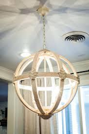 chandeliers 11 ways to get the fixer upper look in your home hanging basket chandelier