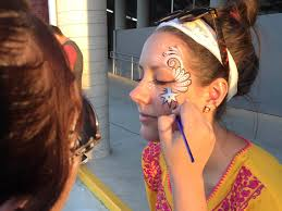 artist applying custom face paint