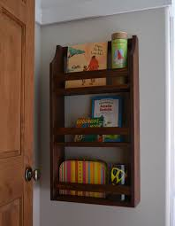 It's inspired of course by the Pottery Barn Kids Hayden Magazine Rack ...  only my DIY version cost about $10 to make, instead of $89.