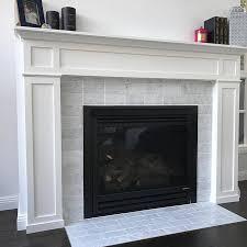 carrara subway marble tile fireplace