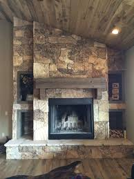 Here are some very different fireplace looks where the Black Moss stone has  made an appearance.