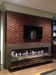 wide wall hung electric fireplace heater with dark brown small tile frame and brown wood