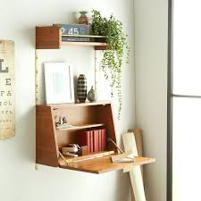 wall mounted pull down desk tiny apartment finds that are basically genius slide out table wall pull down desk