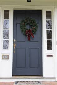 Exterior. Front Door Wreath Ideas adhered on Dark Grey Front Entry Door  with Clear Glass