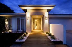 modern lighting design houses. Luxurious Home Entrance Design With Modern Lighting And Wall Lamps Wooden Deck Concrete Planter Houses