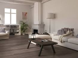 Living Room With Dark Wood Floors WIth White Sofa And Standing Lamp