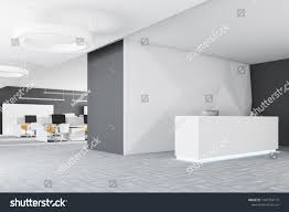 office reception desk. White Office Reception Desk With Two Computers Standing In A Modern Company Headquarters. An Open O