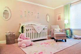 alphabet rug reference for traditional nursery with word art pink wall beige armchair and pink bedding