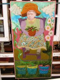"""quilts & """"Garden Imp"""" – Art quilt, raw edge reverse applique, machine quilted, photo  transfer face, embellished with vintage buttons, lace and clothespins, ... Adamdwight.com"""