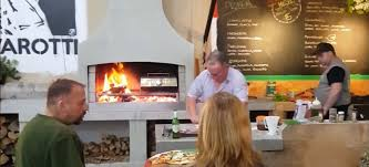 enjoy a wood fired pizza oven plus the warmth of an outdoor fireplace