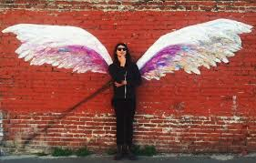 the city s name is now a vision in street art  on angel wings wall art los angeles address with angel s wings roam the streets of los angeles kcet