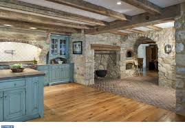 Cottage Design Ideas 2 tags cottage room with interior rock wall arched doorway stained cabinet doors exposed beam
