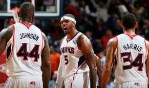 Josh Smith, Devin Harris, Ivan Johnson - Devin Harris and Ivan Johnson  Photos - Utah Jazz v Atlanta Hawks - Zimbio