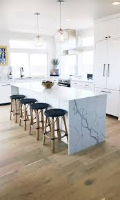 Beach house kitchen with Dal Tile One quartz countertops, Statuary ...