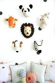 stuffed animal wall mount various felt heads for decorating a kids playroom diy