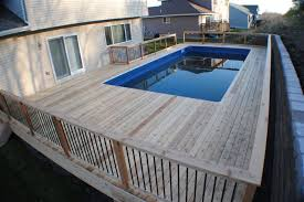 above ground pool decks. Above Ground Pools Decks Idea   18×38 Rectangle With Auto Cover \u0026 Stamped Concrete Pool