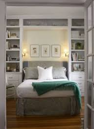 The photos and paintings on display in this large built-in shelf are  protected by the wood headboard just beneath it.