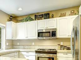 decor above kitchen cabinets. Delighful Kitchen Decorative Items With Distressed Finishes Source  Behr Kitchen Design  Canisters Above Cabinets For Decor Above Kitchen Cabinets O