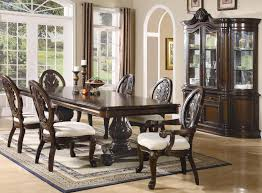 coaster tabitha traditional round dining table with glass top from traditional style dining room buffet furniture source coasterfurniture com