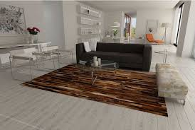 brown patchwork patchwork cowhide rug stripes design