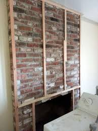 i will be placing a television over the unit is it safe to add framing and sheet rock over the brick and install this insert