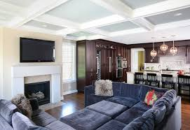 interior design family room traditional with wood flooring flat screen tv above fireplace lighting97 lighting