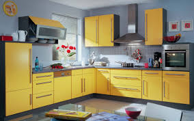 best way to change kitchen cabinet color with warm blue wall paint and yellow cabinet also using wall clock