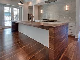 black walnut countertop with matching floor by oak broad