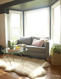 Combine window seat with in-wall storage to create a perfect reading nook.