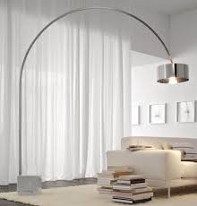 mid century modern arc floor lamps above white fabric sofa and with regard to mid