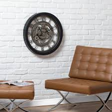 Each has their own story as they tell the time and hang on the wall or sit on the dresser. Studio Designs Home Pinnacle Large 24 Inch Decorative Vintage Industrial Gear Wall Clock With Large Arabic Numerals Glass Open Face 73012 The Home Depot