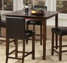 the simplistic elegance of this weitzmenn counter height dining table by homelegance makes it a great addition for smaller dining es