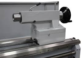 lathe tailstock. the heavy duty tailstock has a 6mt quill. it also features tag along attachment lathe -