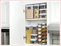 labeled containers ina kitchen cabinet