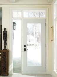 a decorative vertical window positioned on the left side of an entry door